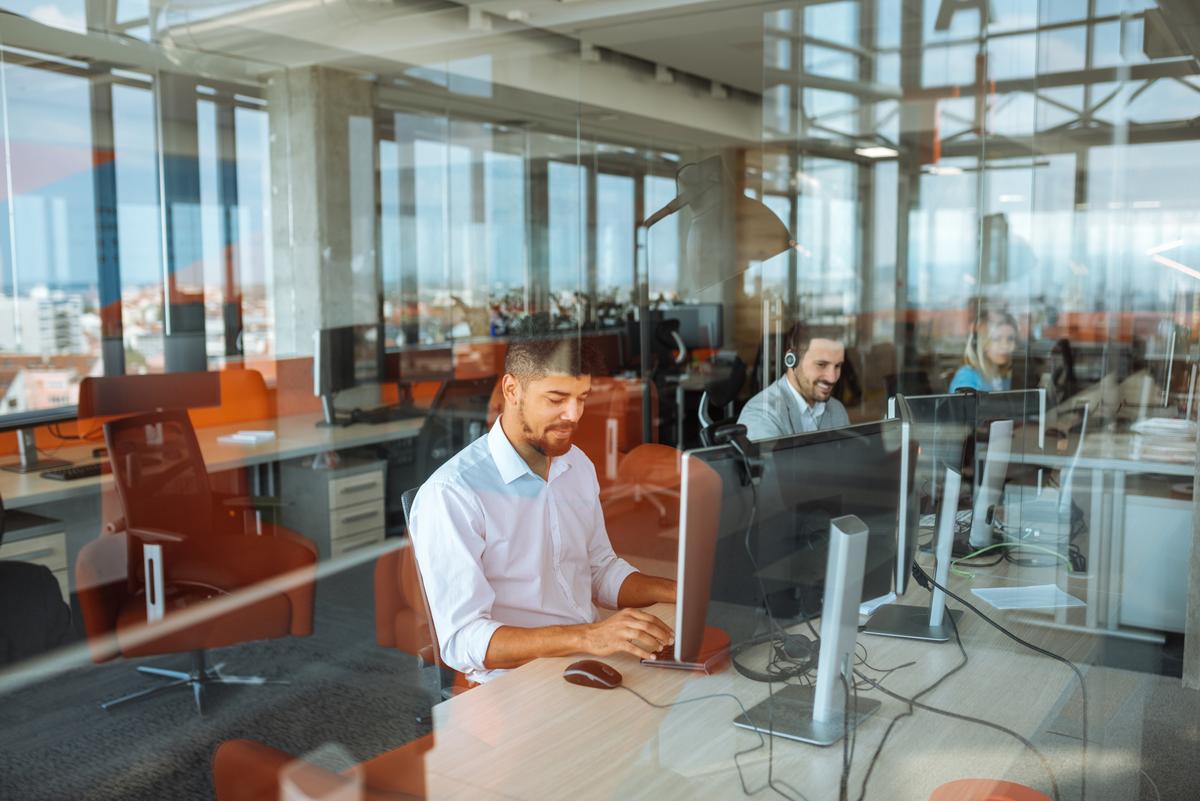 men-using-desktop-computers